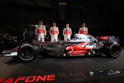 Gary Paffett, Lewis Hamilton, Heikki Kovalainen and Pedro de la Rosa pose with the new McLaren Mercedes MP4-23