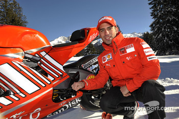 Marco Melandri poses with the Ducati Desmosedici GP8
