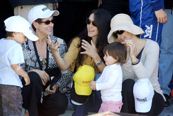 Victory lane: race winners Judy Pruett, Connie Montoya and Ashley Judd celebrate their husbands' victory