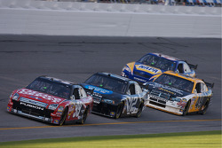 Carl Edwards leads a group of cars