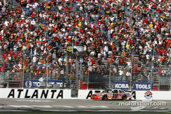 Kyle Busch takes the checkered flag to secure the victory and give Toyota its first win in the Sprint Cup Series