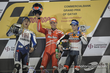 Podium: race winner Casey Stoner with Jorge Lorenzo and Dani Pedrosa