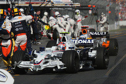 Pit stop for Robert Kubica,  BMW Sauber F1 Team and Fernando Alonso, Renault F1 Team