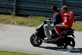Kimi Raikkonen, Scuderia Ferrari on a scooter after he stopped on track