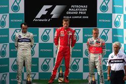 Podium: race winner Kimi Raikkonen, second place Robert Kubica, third place Heikki Kovalainen