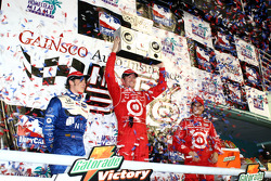 Podium: race winner Scott Dixon celebrates with Marco Andretti and Dan Wheldon
