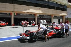 McLaren Mercedes, MP4-23 pushed past Force India F1 Team, garages