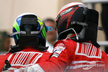 Race winner Felipe Massa celebrates with Kimi Raikkonen