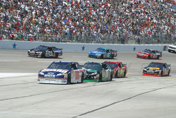 Dale Earnhardt Jr leads the line to pit lane