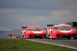 Ferrari racing action on start finish straight