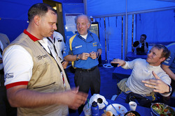 HRH Prince Feisal Al Hussein, Team Principal David Richards and Petter Solberg in the service area