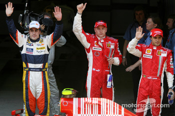 Pole winner Kimi Raikkonen with Fernando Alonso and Felipe Massa