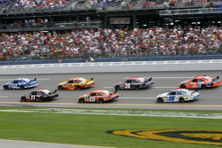 Ryan Newman and Denny Hamlin lead a group of cars
