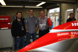 Jason Priestley and Jim Freundenberg, co-owners of Rubicon Race Team, pose with their driver Max Papis