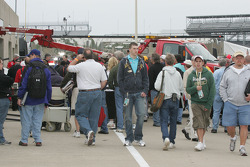 Crowds gather to watch Alex Lloyd's damaged car returned to the garage