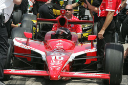 A crew member fires the car for Dan Wheldon to qualify