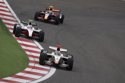 Vitaly Petrov leads Romain Grosjean and Sebastien Buemi