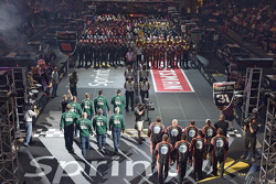 The NASCAR Sprint Pit Crew Challenge at the Time Warner Cable Arena in Charlotte: the National Guard Team and the AT&T crews are introduced