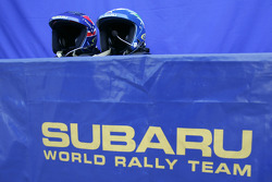 The helmets of Petter Solberg and Phil Mills in the SWRT service area