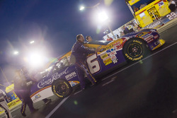 The Crown Royal Crew push their car towards the frontstretch before the start of the NASCAR Sprint All-Star race