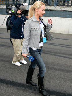 Cora Schumacher, wife of Ralf Schumacher, on the grid working for DTM TV