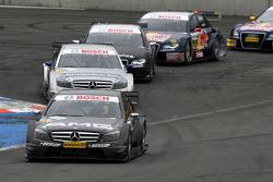 Paul di Resta, Team HWA AMG Mercedes, AMG Mercedes C-Klasse, leads Bruno Spengler, Team HWA AMG Mercedes, AMG Mercedes C-Klasse, Timo Scheider, Audi Sport Team Abt, Audi A4 DTM, Mattias Ekström, Audi Sport Team Abt Sportsline, Audi A4 DTM and Martin Tomc