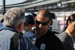 Tony Kanaan holding his baby