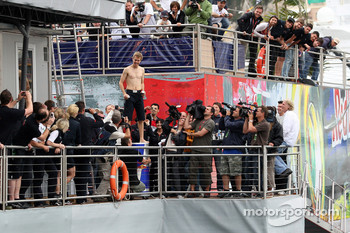 Sebastian Vettel, Scuderia Toro Rosso, jumps off the Red Bull Energy Station into the harbour / port