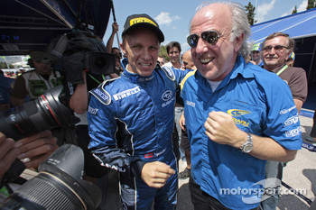 Second place Petter Solberg celebrates with David Richards