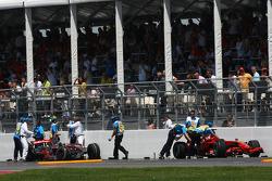 The crash damaged cars of Kimi Raikkonen, Scuderia Ferrari and Lewis Hamilton, McLaren Mercedes