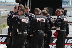 Helio Castroneves crew has a team meeting