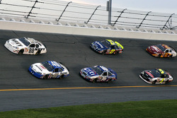 Brad Keselowski and Bryan Clauson lead a group of cars