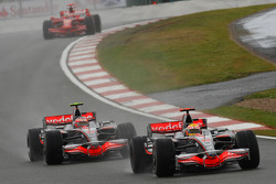 Lewis Hamilton, McLaren Mercedes, MP4-23, Heikki Kovalainen, McLaren Mercedes, MP4-23 and Kimi Raikkonen, Scuderia Ferrari, F2008