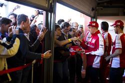 Kimi Raikkonen and Sebastian Vettel, Ferrari sign autographs for the fans