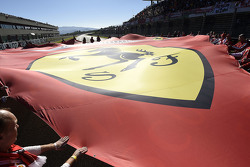 Scuderia Ferrari flag on the starting grid