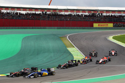 Jenson Button, McLaren MP4-30 and Marcus Ericsson, Sauber C34 at the start of the race