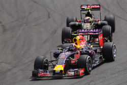 Daniil Kvyat, Red Bull Racing RB11 leads Pastor Maldonado, Lotus F1 E23