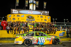 Victory lane: race winner and 2015 NASCAR Sprint Cup series champion Kyle Busch, Joe Gibbs Racing Toyota celebrates with wife Samantha and his team