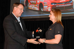 Erica Enders is given an award from General Motors Vice President Motorsports and Performance Vehicles Jim Campbell