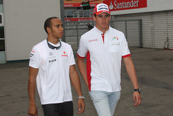 Lewis Hamilton, McLaren Mercedes with Adrian Sutil, Force India F1 Team