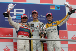 Romain Grosjean celebrates his victory on the podium with Giorgio Pantano and Alvaro Parente