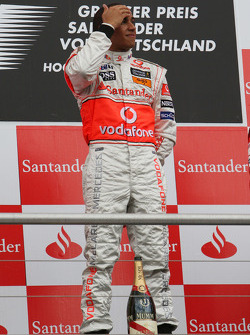 Podium: race winner Lewis Hamilton