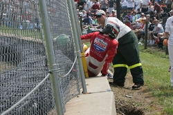Richard Antinucci climbs through the fence