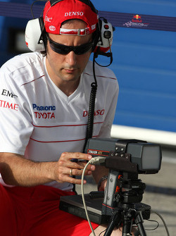 A Toyota Racing engineer, taking readings