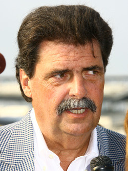 NASCAR President Mike Helton speak with the media