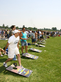 Race fans play corn-hole in infield