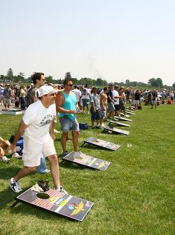 Race fans play corn-hole in infield