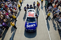 The Sears Dodge gets pushed out of the garage and onto pit road