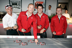 Rinaldo Capello, Alexandre Prémat, Mike Rockenfeller and Allan McNish play slot cars