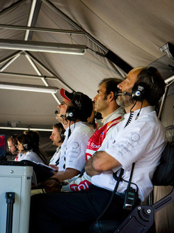 Audi Sport North America team members watch timing and scoring monitors during qualifying